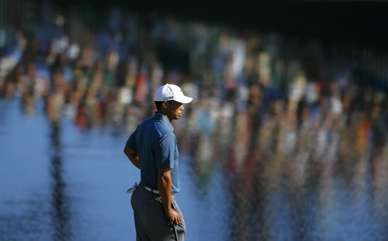Tiger Woods of the U.S. waits to putt on the 15th green during third round play in the 2013 Masters golf tournament at the Augusta National Golf Club in Augusta, Georgia, April 13, 2013. (Brian Snyder/Reuters)