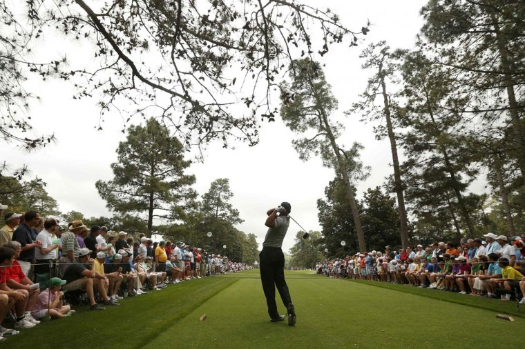 Tiger Woods of the U.S. hits his tee shot on the ninth hole during first round play in the 2013 Masters golf tournament at the Augusta National Golf Club in Augusta, Georgia, April 11, 2013. (Mark Blinch/Reuters)