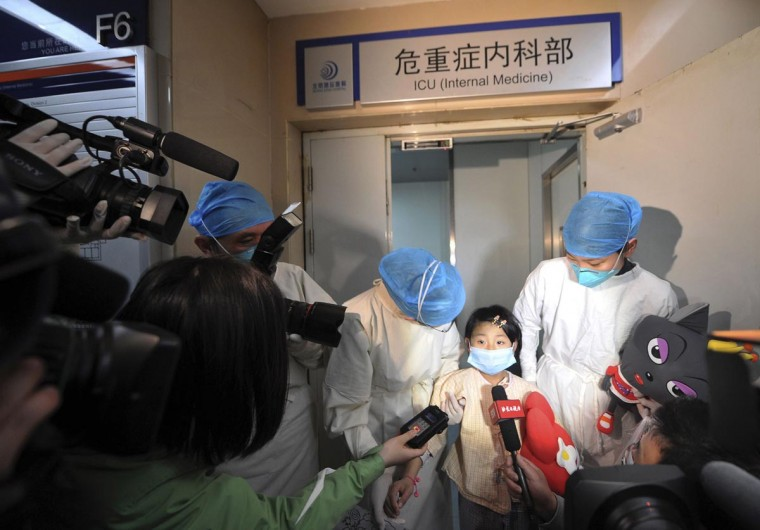 A girl, who was previously infected with the H7N9 bird flu virus, talks to the media as she is transferred from the ICU to a public ward at Ditan hospital in Beijing April 15, 2013. According to a hospital spokesperson, the H7N9 virus is no longer detected in the girl's body. Two people in the central Chinese province of Henan have been infected by the new strain of avian influenza, the first cases found in the region, while the death toll has risen to 13 from a total of 60 infections after two more deaths in Shanghai. (Stringer/Reuters)