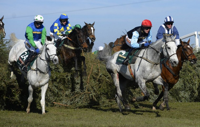 Ryan Mania riding Auroras Encore (second left) jumps over the Chair on his way to win the Grand National Steeplechase at Aintree, northern England on April 6, 2013. Also seen are Swing Bill ridden by Conor O'Farrell (left), Quel Esprit ridden by Paul Townend (second from right) and Teaforthree ridden by Nick Scholfield (right). (Russell Cheyne/Reuters)