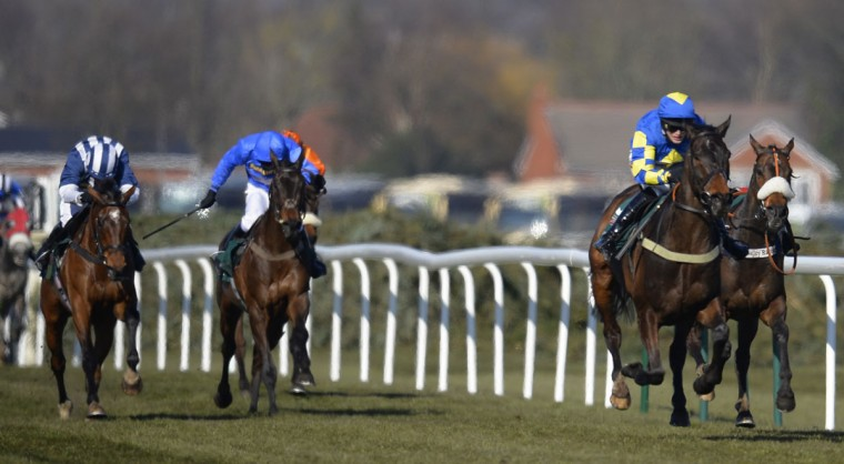 Ryan Mania riding Auroras Encore (right) crosses the line to win the Grand National Steeplechase at Aintree, northern England April 6, 2013. (Russell Cheyne/Reuters)
