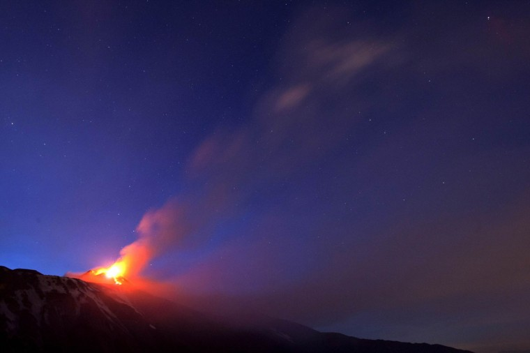 Italy's volcanic Mount Etna spews lava during an eruption on the southern Italian island of Sicily April 11, 2013. Mount Etna is Europe's tallest and most active volcano. (Antonio Parrinello/Reuters)