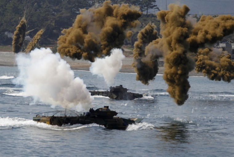 South Korean Marine Corps take part in a practice for a U.S.-South Korea joint landing operation drill in Pohang, about 370 km (230 miles) southeast of Seoul. The landing operation drill, which will be held on Friday is a part of the two countries' annual military training called Foal Eagle which began on March 1 and runs until April 30. (Lee Jae-Won/Reuters photo)