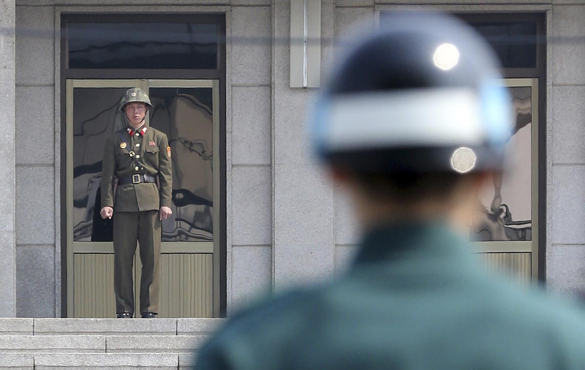 Paju-si South Korea  city pictures gallery : North Korean soldier L and a South Korean soldier keep watch at ...