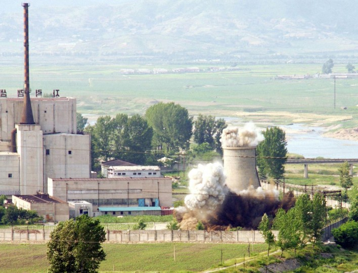 A cooling tower of Yongbyon nuclear reactor in North Korea is seen being demolished in this June, 27, 2008 file picture released by Yonhap news agency in Seoul April 2, 2013. North Korea is to restart the mothballed Yongbyon nuclear reactor that has been closed since 2007 in a move that could produce more plutonium for nuclear weapons as well as for domestic electricity production, its KCNA news agency said on Tuesday. (Yonhap/Files via Reuters)