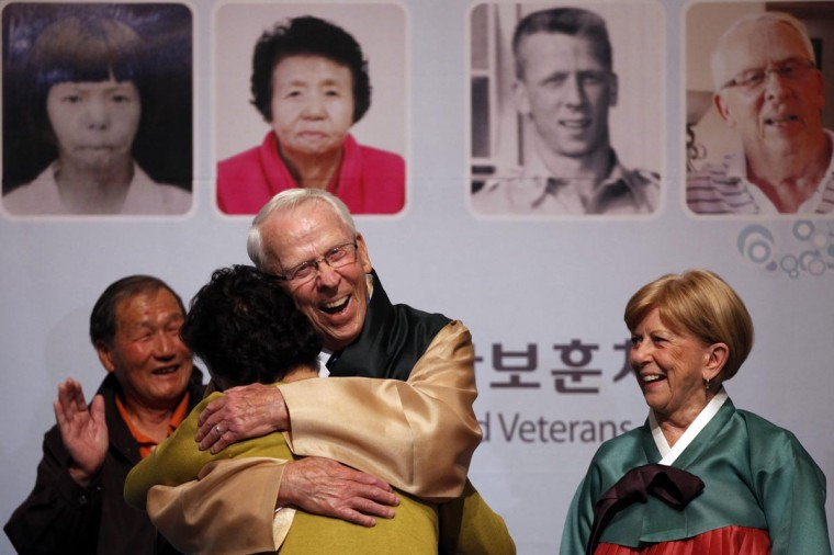 Richard Cadwallader (facing camera), 82, hugs Kim Yeon-soon, 72, during a reunion ceremony at a hotel in Seoul April 1, 2013. War veteran Cadwallader, who had served in the U.S. Air Force during the Korean War, was reunited with Kim, whom he helped receive treatment for burns she had sustained as a girl, on Monday for the first time in 60 years after a decades-long search, the Ministry of Patriots and Veterans Affairs said. Kim had sustained the burns during an accident when a relative had dropped an oil lamp on her, according to local media. (Kim Hong-Ji/Reuters)