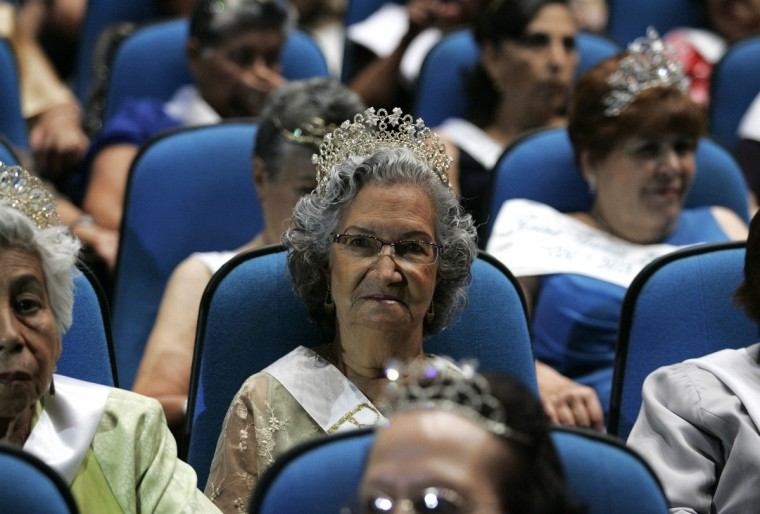 "Elderly women wearing tiaras sit in the audience during a beauty pageant for elderly women called the ""Queen of the Elderly"" in Guadalajara. Eight contestants, ranging in age from 65-75, answered questions about their lives and what it means to be a senior citizen in today's society, as they competed in the annual event to win the top prize of a handbag and jewelery creations by local designers. (Alejandro Acosta/Reuters photo)"