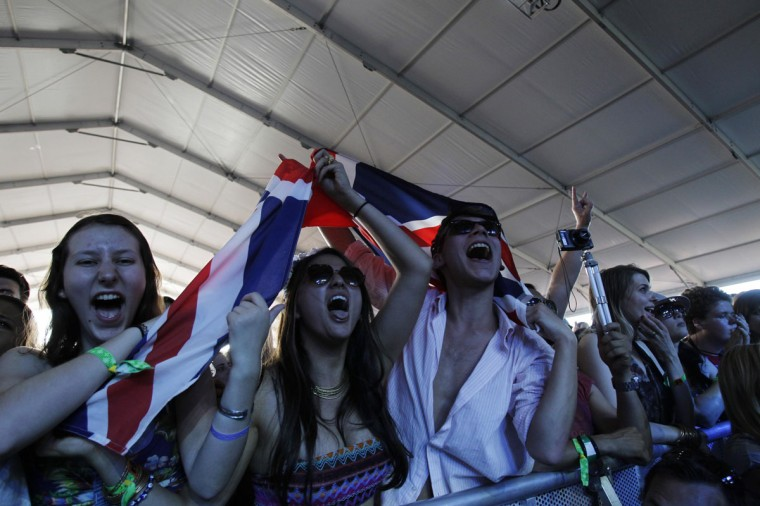 Concert-goers hold a British flag as they watch the band Alt-J perform during the Coachella Music Festival in Indio, California on April 12, 2013. (Mario Anzuoni/Reuters)