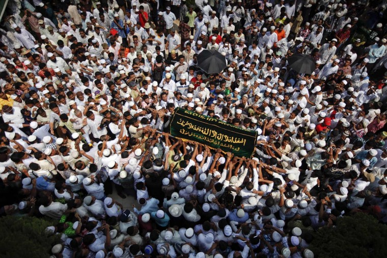 People carry a coffin during the funeral for victims of a fire at Yaeway cemetery in Yangon April 2, 2013. Thousands of Muslims attended the funeral for the 13 victims of the fire that broke out in a dormitory of an Islamic school in the central, multi-ethnic Botataung district of the former capital. The fire caused by faulty electrical equipment killed 13 boys at the school in Yangon on Tuesday, the fire service said. (Minzayar/Reuters)