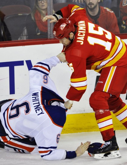 Calgary Flames' Tim Jackman (R) and Edmonton Oilers' Ryan Whitney fight during the third period of their NHL hockey game in Calgary. (Dan Riedlhuber /Reuters photo)