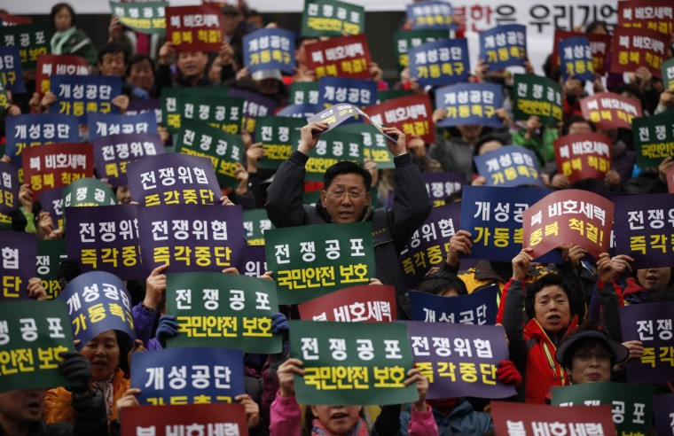 Members of the Korea Freedom Federation chant slogans during a rally for North Korea to re-start operations at the joint Kaesong Industrial Complex (KIC), at a railway station in Seoul. (Kim Hong-Ji/Reuters photo)
