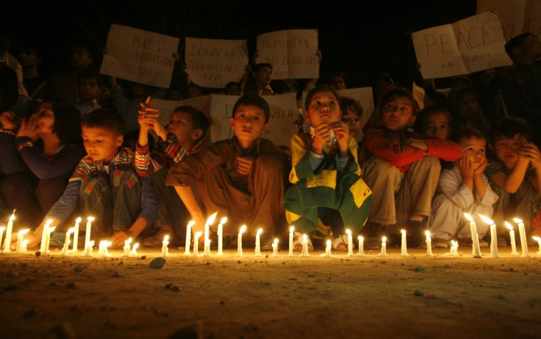 Shi'ite Muslims hold a candlelight vigil at the site of an April 23 bomb attack, in tribute to the victims, in Quetta. Pakistan's ethnic Hazara minority suffered a fresh blow on April 23, when a suicide car bomber killed at least five people and wounded dozens in the attack in Quetta that came close to killing one of the community's top politicians, police said. (Naseer Ahmed/Reuters)
