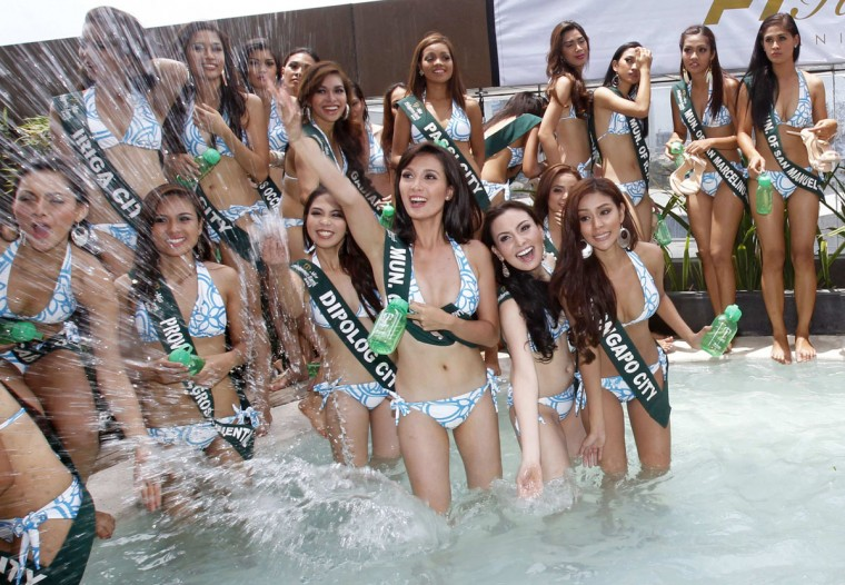 Candidates of the annual Miss Philippines-Earth 2013 pageant splash water at the poolside during a media presentation at a hotel in Taguig city, metro Manila. The new Miss Philippine Earth will go on to represent the country in the Miss Earth pageant later in the year. (Romeo Ranoco. Reuters)