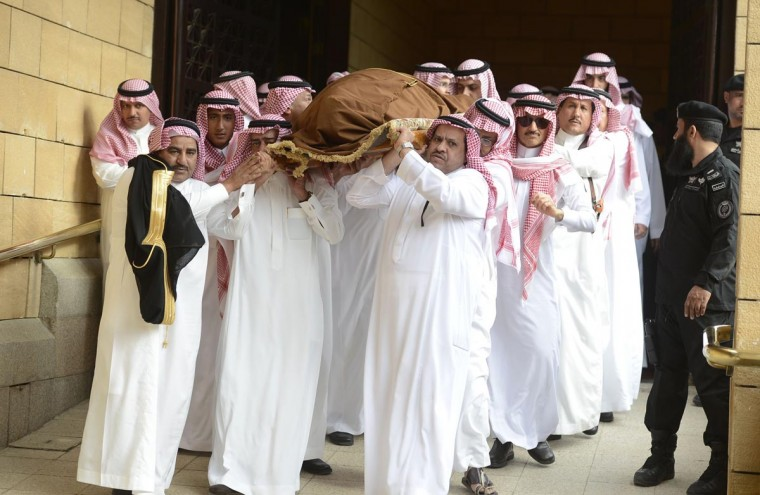 The body of Saudi Arabia's Prince Badr bin Abdul Aziz, former deputy commander of the National Guard is lifted during his funeral at Imam Turki bin Abdullah Mosque in Riyadh, April 2, 2013. (Faisal Al Nasser/Reuters)