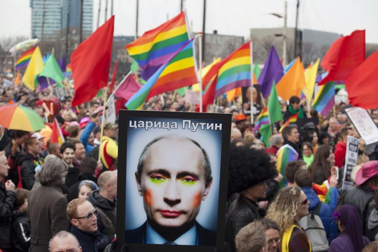 A demonstrator holds up a picture depicting Russian President Vladimir Putin with make-up, during a protest by the gay community in Amsterdam April 8, 2013. Russia does not discriminate against homosexuals, Putin told reporters in Amsterdam on Monday where he was greeted by gay rights and other activists critical of Russia's track record. Putin is on one-day visit in the Netherlands for the start of the Netherlands-Russia Year. (Cris Toala Olivares/Reuters)
