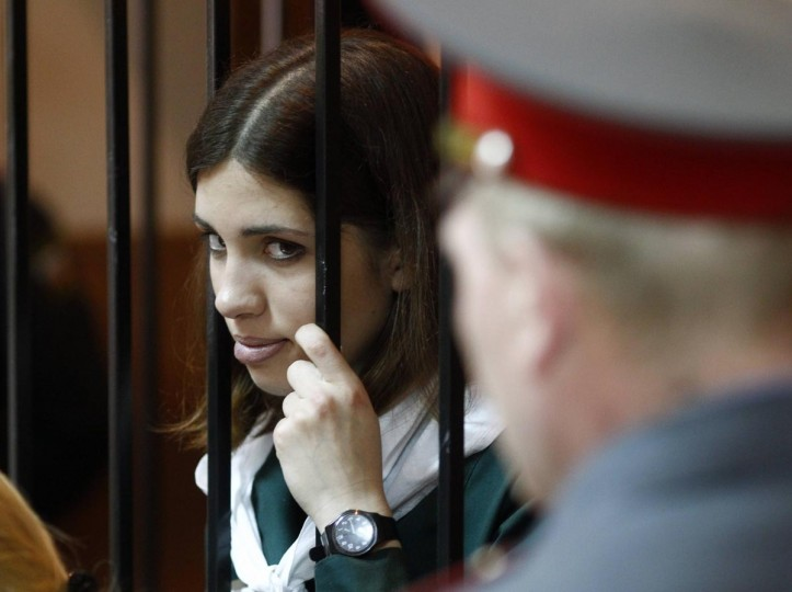 Pussy Riot band member Nadia Tolokonnikova looks out from a holding cell during a court hearing in the town of Zubova Polyana April 26, 2013. Tolokonnikova is appealing her conviction for hooliganism motivated by religious hate for which she is serving two years in a remote penal colony. (Mikhail Voskresensky/Reuters)