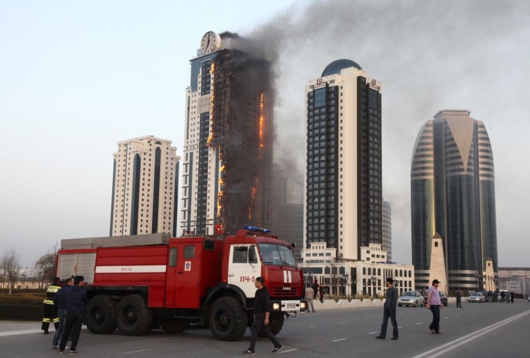 A multi-storey building, which is part of the Grozny-City complex, is seen on fire in the Chechen capital Grozny, April 3, 2013. No casualties were reported. (Yelena Fitkulina/Reuters)