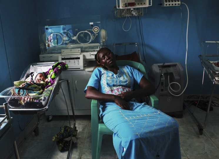 A woman sleeps next to her newborn baby in a nursery in the Juba Teaching Hospital in Juba. Very few births in South Sudan, which has the highest maternal mortality rate in the world at 2,054 per 100,000 live births, are assisted by trained midwives, according to the UNDP's website. (Andreea Campeanu/Reuters photo)