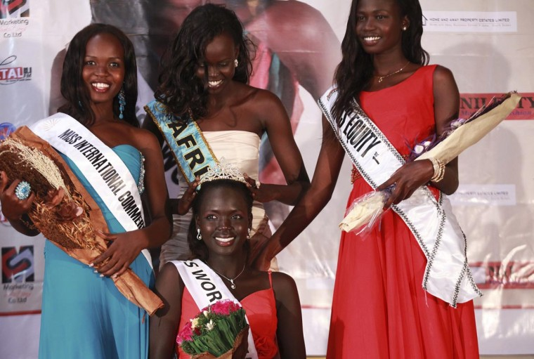 Manuela Matong (C) is crowned Miss World South Sudan during the national final contest in Juba, South Sudan, April 13, 2013. The finals of the Miss World contest will take place in September in Indonesia. Picture taken April 13, 2013. (Andreea Campeanu/Reuters)