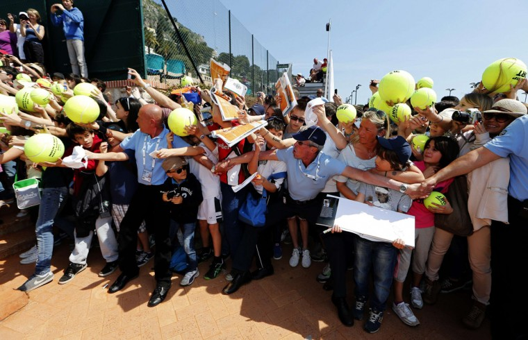 Security hold back fans who wait for an autograph by Spain's Rafael Nadal following a training session during the first round of the Monte Carlo Masters in Monaco. (Eric Gaillard/Reuters)