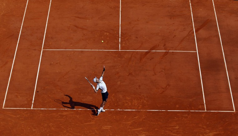 Novak Djokovic of Serbia serves to Juan Monaco of Argentina during the Monte Carlo Masters in Monaco. (Eric Gaillard/Reuters photo)