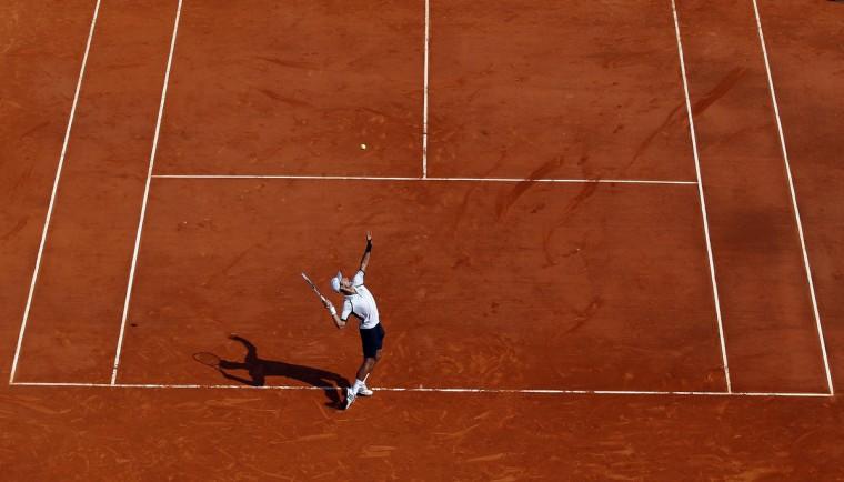 Novak Djokovic of Serbia serves to Juan Monaco of Argentina during the Monte Carlo Masters in Monaco. (Eric Gaillard/Reuters photo)