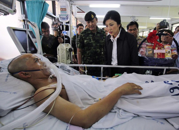 Thailand's Prime Minister Yingluck Shinawatra visits a soldier who was injured during a roadside bomb attack, at a hospital in Yala province, south of Bangkok April 7, 2013. Suspected Muslim rebels in southern Thailand killed a deputy provincial governor and another state official with a roadside bomb on Friday, a week after the government held first formal talks with a rebel group to try to end years of violence. (Surapan Boonthanom/Reuters)