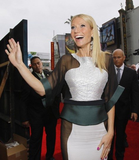 "Cast member Gwyneth Paltrow waves to fans as she arrives at the premiere of ""Iron Man 3"" at El Capitan theatre in Hollywood, California April 24, 2013. The movie opens in the U.S. on May 3. (Mario Anzuoni/Reuters photo)"