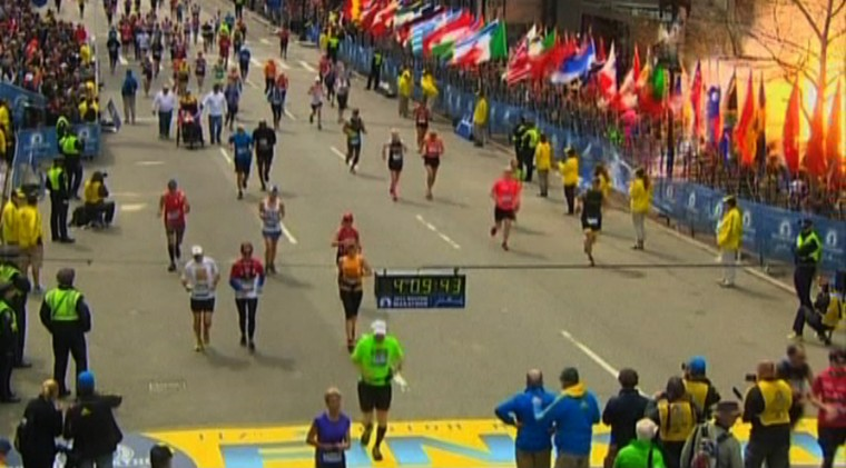 An explosion at the Boston Marathon, April 15, 2013. Two explosions struck the marathon as runners crossed the finish line on Monday, witnesses said, injuring an unknown number of people on what is ordinarily a festive day in the city. (Courtesy of video by NBC/Reuters photo)