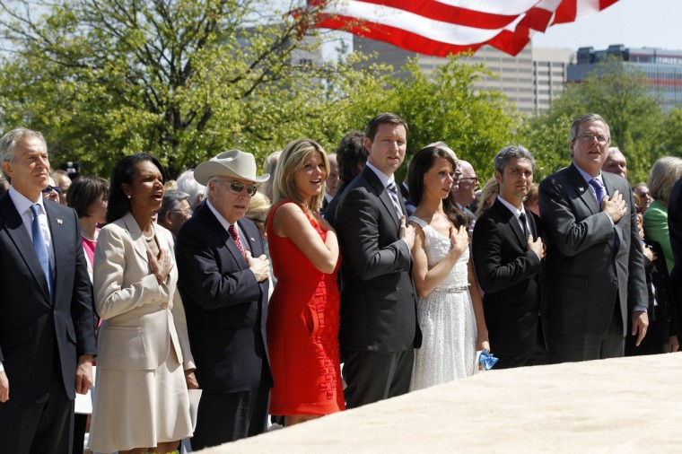 Former colleagues and relatives of former U.S. President George W. Bush, (L-R) Tony Blair, Condoleezza Rice, Dick Cheney, Jenna Bush Hager, Henry Hager, Barbara Bush, her friend Miky Fabrega and George W. Bush's brother Jeb Bush, sing the national anthem during the dedication ceremony for the George W. Bush Presidential Center in Dallas. (Jason Reed/Reuters)