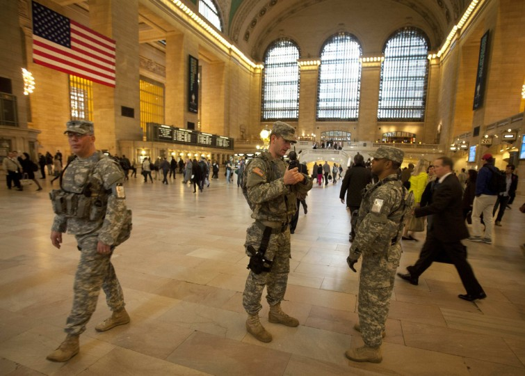 """Members of the U.S. Army National Guard Joint Task Force Empire Shield patrol Grand Central Terminal in New York, April 16, 2013. Two bombs packed with ball bearings tore through crowds near the finish of the Boston Marathon, killing three people and triggering a massive hunt for those behind an attack the White House said would be treated as """"an act of terror"""". (Carlo Allegri/Reuters photo)"""