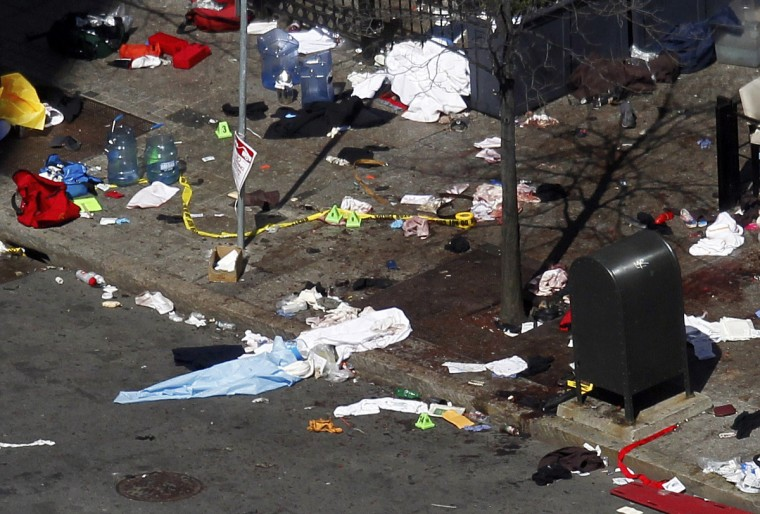 """Blood and debris are seen on the sidewalk along Boylston Street a day after two explosions at the Boston Marathon in Boston, Massachusetts April 16, 2013. Two bombs packed with ball bearings tore through crowds near the finish line of the Boston Marathon on Monday, killing three people and triggering a massive hunt for those behind an attack the White House said would be treated as """"an act of terror."""" (Jessica Rinaldi/Reuters photo)"""