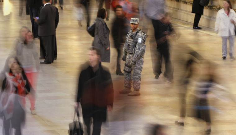 """A member of the U.S. Army National Guard Joint Task Force Empire Shield stays vigilant as he stands guard at Grand Central Terminal in New York, April 16, 2013. Two bombs packed with ball bearings tore through crowds near the finish of the Boston Marathon, killing three people and triggering a massive hunt for those behind an attack the White House said would be treated as """"an act of terror"""". (Carlo Allegri/Reuters)"""