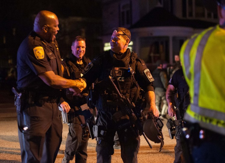 Police officers and SWAT team members greet each other after a police assault on a house on Franklin Street in Watertown, Massachusetts April 19, 2013. The manhunt for Dzhokhar Tsarnaev, 19, one of two brothers believed to have carried out the Boston Marathon bombing on Monday ended with his capture while hiding in the stern of a boat parked in the backyard of a house. (John Taggart/Reuters)