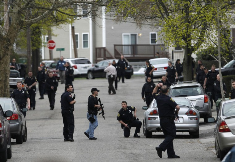 Police officers search homes for the Boston Marathon bombing suspects in Watertown, Massachusetts April 19, 2013. Police on Friday killed one suspect in the Boston Marathon bombing during a shootout and mounted a house-to-house search for a second man in the suburb of Watertown after a bloody night of shooting and explosions in the city's streets. (Jessica Rinaldi/Reuters)