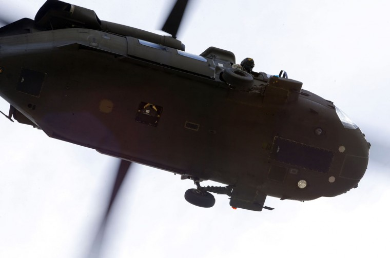 One of two National Guard Black Hawk helicopters circles over the neighborhood where a second suspect in the Boston Marathon bombings is believed to be hiding in Watertown, Massachusetts. (Brian Snyder/Reuters)