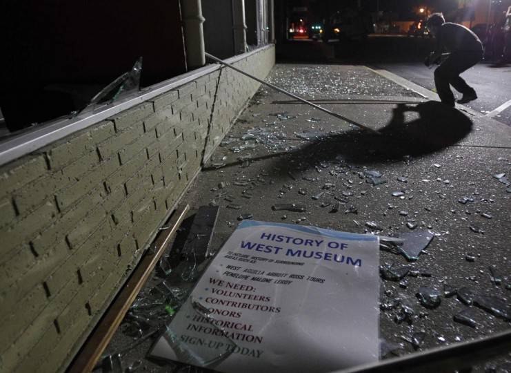 A sign rests on a sidewalk amid shattered glass after an explosion at a fertilizer plant in the town of West, near Waco, Texas early April 18, 2013. (Mike Stone/Reuters)
