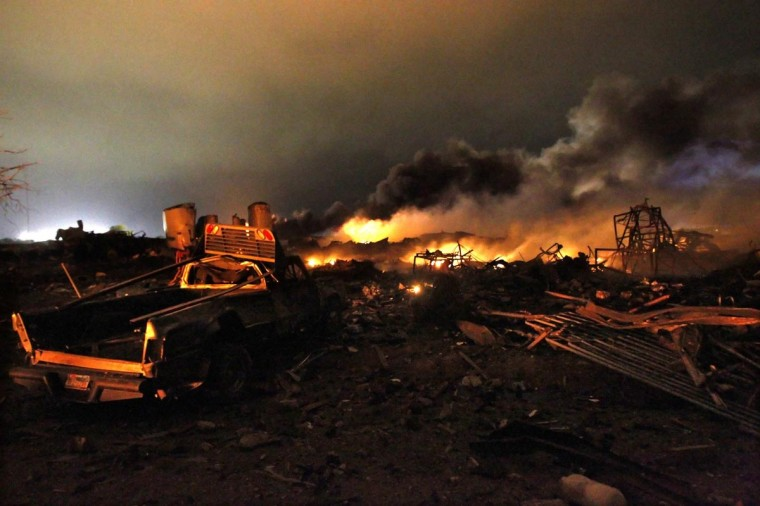A vehicle is seen near the remains of a fertilizer plant burning after an explosion at the plant in the town of West, near Waco, Texas early April 18, 2013. (Mike Stone/Reuters)