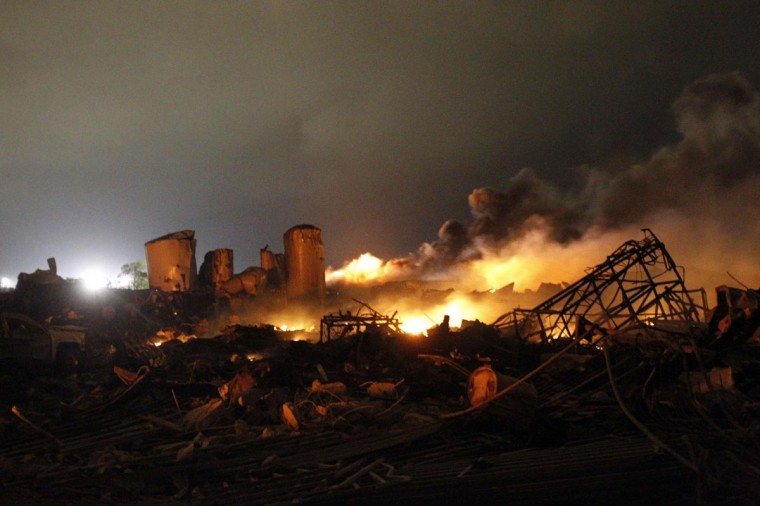 The remains of a fertilizer plant burn after an explosion at the plant in the town of West, near Waco, Texas early April 18, 2013. The deadly explosion ripped through the fertilizer plant late on Wednesday, injuring more than 100 people, leveling dozens of homes and damaging other buildings including a school and nursing home, authorities said. (Mike Stone/Reuters)