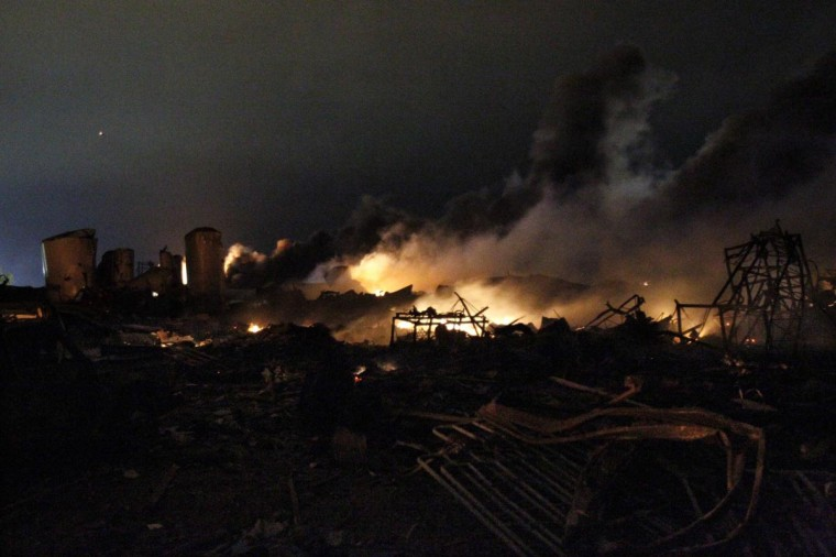 The remains of a fertilizer plant burn after an explosion at the plant in the town of West, near Waco, Texas early April 18, 2013. (Mike Stone/Reuters)