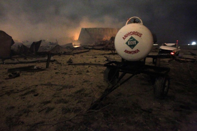 A chemical trailer sits among the remains of a fertilizer plant burning after an explosion at the plant in the town of West, near Waco, Texas early April 18, 2013. (Mike Stone/Reuters)