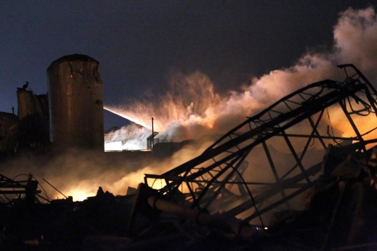Smoke rises as water is sprayed at the burning remains of a fertilizer plant after an explosion at the plant in the town of West, near Waco, Texas early April 18, 2013. The deadly explosion ripped through the fertilizer plant late on Wednesday, injuring more than 100 people, leveling dozens of homes and damaging other buildings including a school and nursing home, authorities said. (Mike Stone/Reuters)