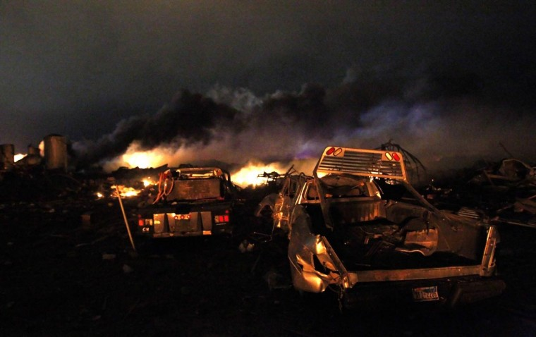 Vehicles are seen near the remains of a fertilizer plant burning after an explosion at the plant in the town of West, near Waco, Texas early April 18, 2013. (Mike Stone/Reuters)