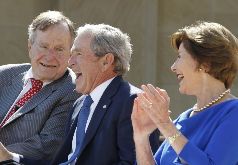 Former U.S. presidents George W. Bush (C) and his father George H.W. Bush laugh alongside former first lady Laura Bush (R) during the dedication ceremony for the George W. Bush Presidential Center in Dallas. (Jason Reed/Reuters)