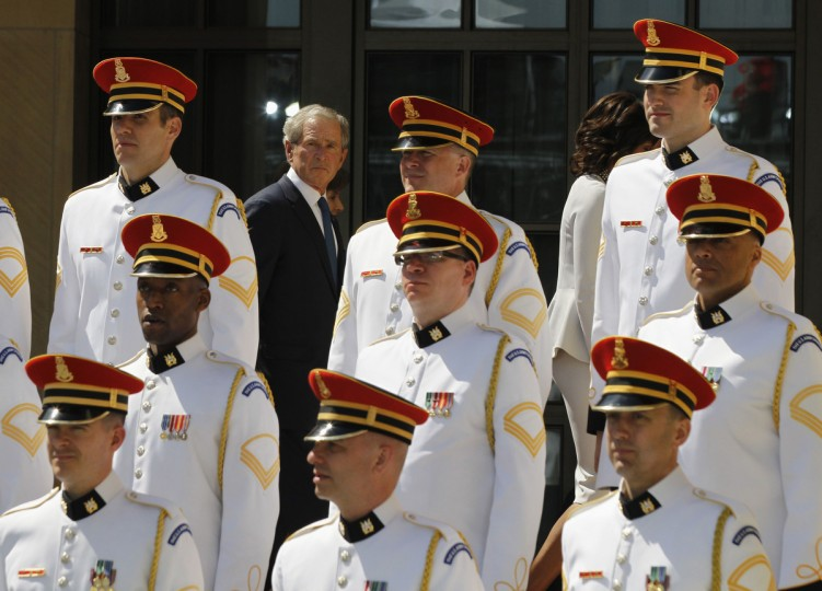 Former U.S. president George W. Bush walks behind a military choir at the end of a dedication ceremony for the George W. Bush Presidential Center in Dallas. (Jason Reed/Reuters)