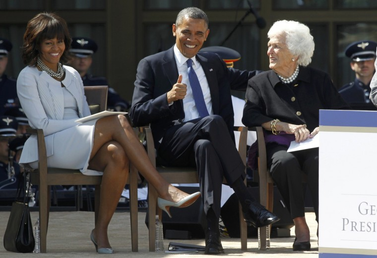 U.S. President Barack Obama (C) gives a thumbs up at the dedication for the George W. Bush Presidential Center seated next to First lady Michelle Obama (L) and former first lady Barbara Bush (R) on the campus of Southern Methodist University in Dallas, Texas. (Mike Stone/Reuters)