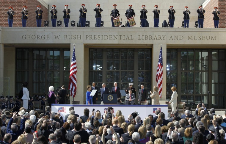 (L-R) U.S. First lady Michelle Obama, former first lady Barbara Bush, former first lady Laura Bush, President Barack Obama, former President George W. Bush, former President Bill Clitnon, former President George H.W. Bush, former President Jimmy Carter, former first lady Hillary Clinton, and former first lady Rosalynn Carter arrive at the dedication for the George W. Bush Presidential Center on the campus of Southern Methodist University in Dallas. (Mike Stone/Reuters)