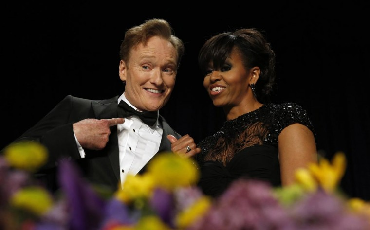 Comedian Conan O'Brien poses with U.S. first lady Michelle Obama during the White House Correspondents Association Dinner in Washington April 27, 2013. (Kevin Lamarque/Reuters)