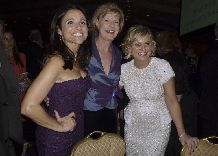 Actresses Julia Louis-Dreyfus (L) and Amy Poehler (R) pose with Democratic U.S. Senator Tammy Baldwin (D-WI), the first openly gay U.S. Senator in history, at the annual White House Correspondents' Association dinner in Washington April 27, 2013. (Jim Bourg/Reuters)