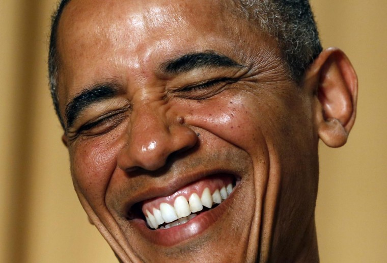 U.S. President Barack Obama laughs as comedian Conan O'Brien speaks during the White House Correspondents Association Dinner in Washington April 27, 2013. (Kevin Lamarque/Reuters)